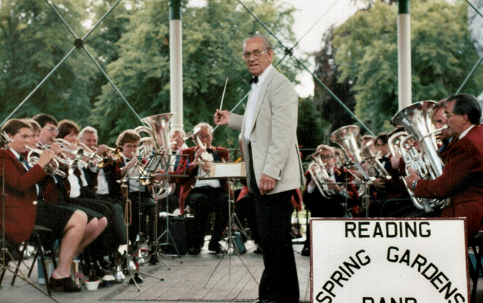 Ted Watkins pictured conducting the band and led by principal cornet player Lorraine Rogers